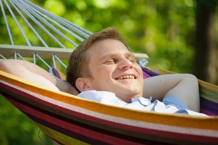 Young man sleeping in a hammock photo