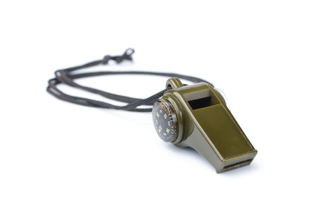 The green whistle on a white background photo