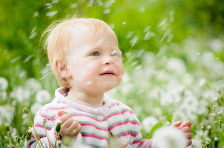 Outdoor portrait of a cute little baby in the grass Stock Photo - 10132185