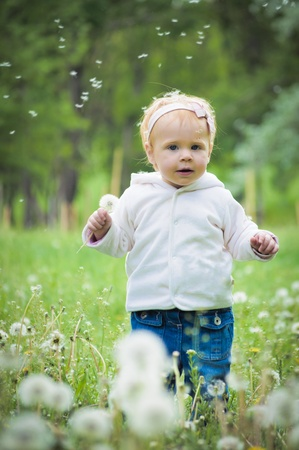 Outdoor portrait of a cute little baby in the grass Stock Photo - 10132190