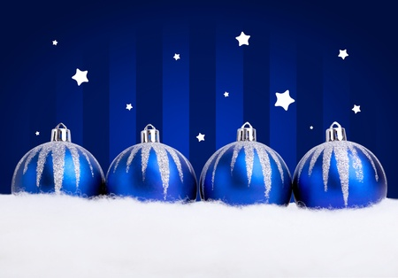 Glittering blue christmas balls on dark  background. Copy space for your text. photo