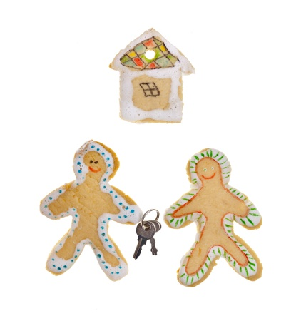 Gingerbread house with a keys on white background photo