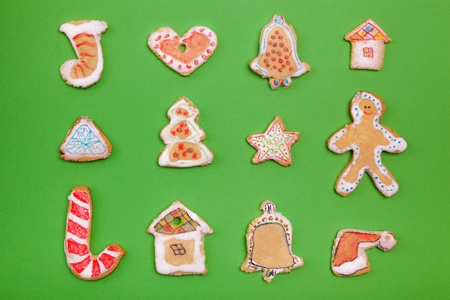 home decorated: Homemade Gingerbread cookies  on green background Stock Photo