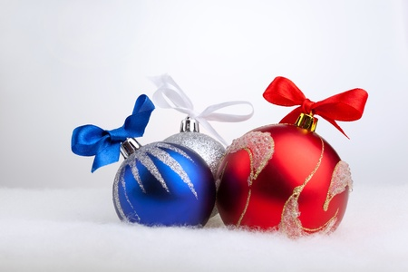 Glittering christmas balls on the white background photo
