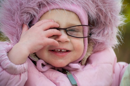This is Closeup of funny baby in glasses photo