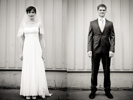 Full Lenght Porträt von Braut und Bräutigam stehen gegen Wand Standard-Bild - 11792853