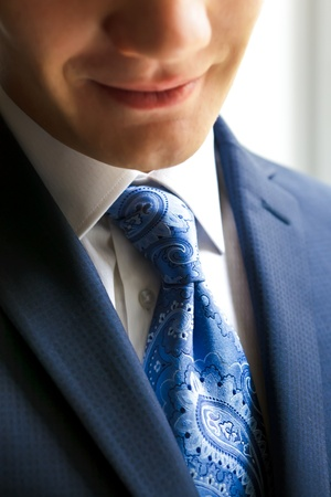 suite: This is Closeup of young businessman smiling Stock Photo