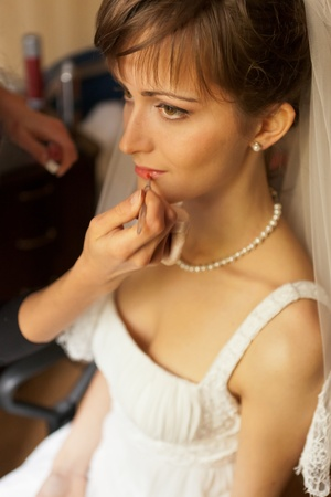 This is photograph of Bride getting make-up photo