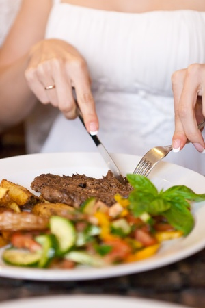 surfeit: This is closeup of woman eating in restaurant