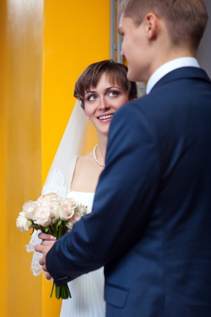 Bride and groom looking to each other - outdoor Stock Photo - 11792805