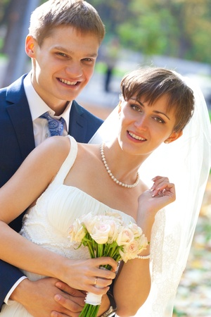 Beautiful Bride and groom together in park photo