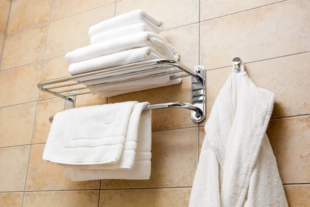 bathrobes: This is a closeup of a towels and bathrobes