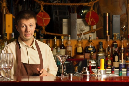 This is portrait of a barman at work - indoors photo