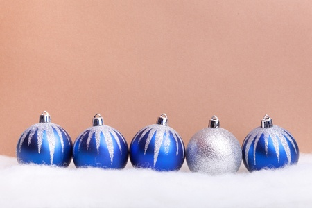 Glittering blue christmas balls on background. Copy space for your text. photo