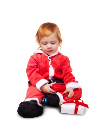 Portrait of little cute baby in red suite of Santa  isolated over white photo