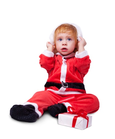 Portrait of little cute baby in red suite of Santa  isolated over white Stock Photo - 12470929