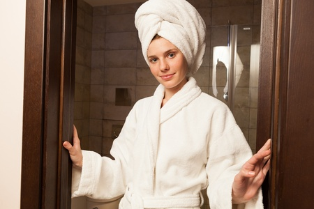 house robe: Young woman wearing a white robe in the hotel