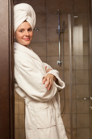 a white robe: Young woman wearing a white robe in the hotel