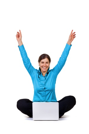 winning woman: Happy woman with laptop computer isolated on white