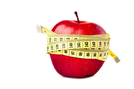 measure tape: Red apple with measure tape on white background