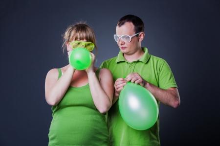 Happy young couple having fun with balloons - studio shot Stock Photo - 15038460