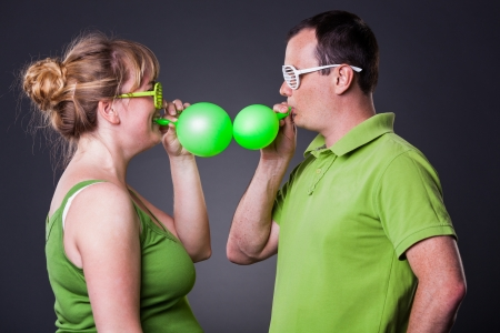 Happy young couple having fun with balloons - studio shot Stock Photo - 15038461