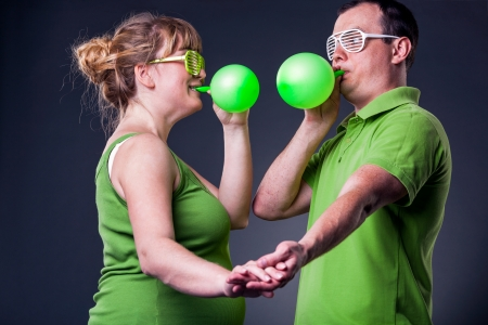 Happy young couple having fun with balloons - studio shot Stock Photo - 15038478