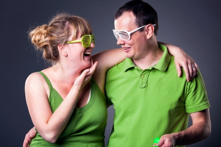 Happy young couple having fun - studio shot photo