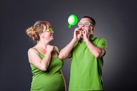Happy young couple having fun with balloons - studio shot Stock Photo - 15038450