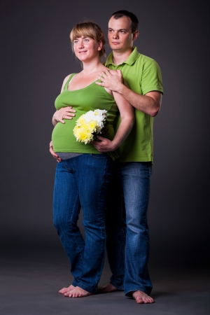 Portrait of happy young family  together - studio shot Stock Photo - 15038465