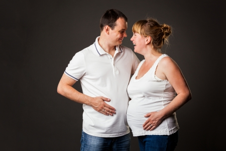 Portrait of young family together - studio shot Stock Photo - 15038433