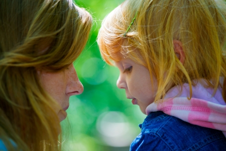 Mother with her daughter outdoors in the park
