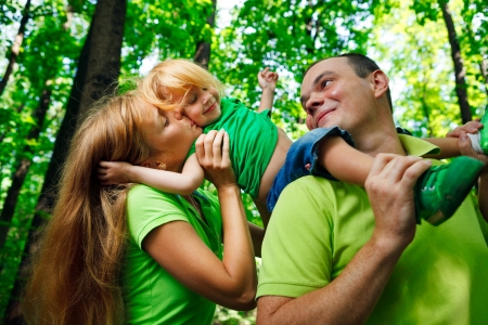 family time: Portrait of a funny family having good time outdoors