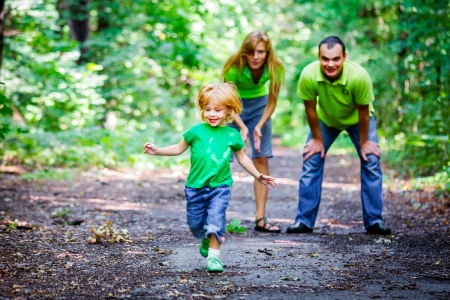 2 years old: Portrait of Happy Family In Park - outdoor shot Stock Photo