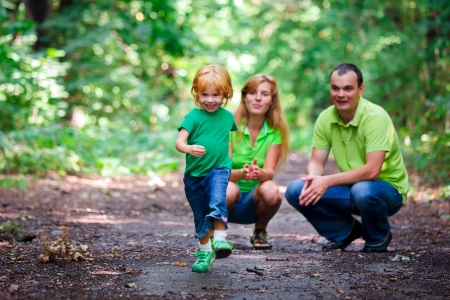 two year old: Portrait of Happy Family In Park - outdoor shot Stock Photo