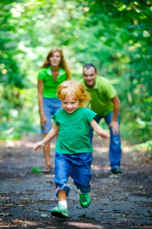 Portrait of Happy Family In Park - outdoor shot Stock Photo