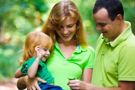 Portrait of Happy Family In Park - outdoor shot Stock Photo - 15310121