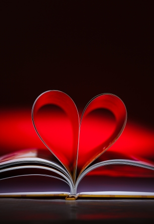 Pages of book curved into a heart shape photo