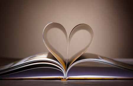 Pages of book curved into a heart shape