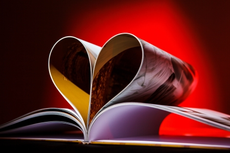 composition book: Pages of book curved into a heart shape