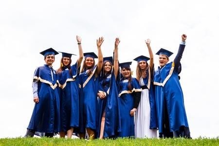 academic achievement: Image of happy young graduates - outdoor shot Stock Photo