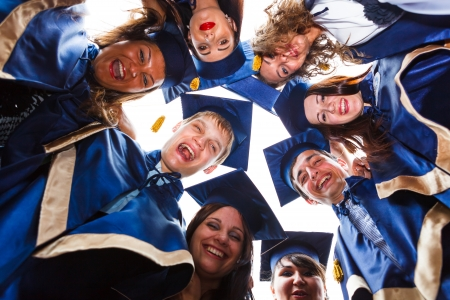 toga: Image of happy young graduates - outdoor shot Stock Photo
