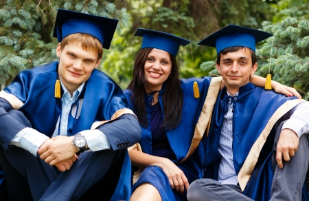 Image of happy young graduates - outdoor shot photo