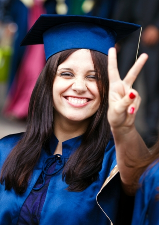 Image of a happy young graduate - outdoor shot photo