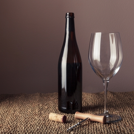 Bottle and glass of red wine - studio shot photo