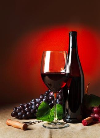 cabernet sauvignon: Bottle and glass of red wine - studio shot Stock Photo