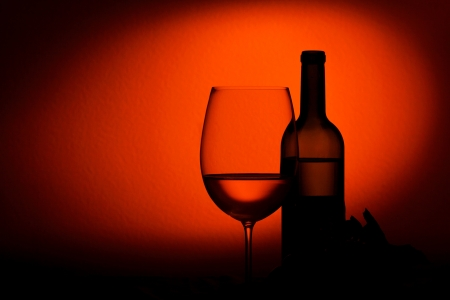 winy: Bottle and glass of wine - studio shot Stock Photo