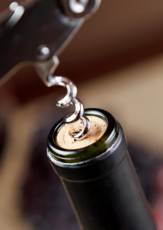 bottle opener: Opening of bottle of wine with corkscrew