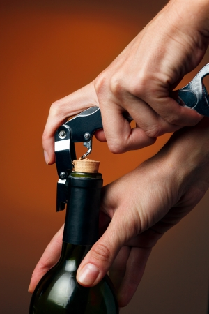 winy: Opening of bottle of wine with corkscrew