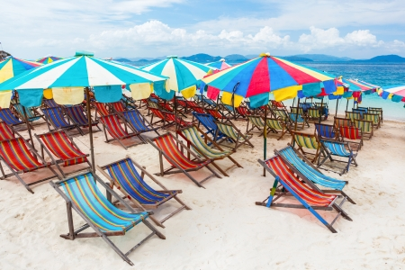 Beach chair and umbrellas on the beach - Kay Island, Thailand photo